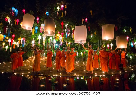 Chiang Mai Thailand November 6 2014 Loy Kratong Festival Buddhist monk fire candles to the Buddha and floating lamp on November 6 2014 in Phan Tao Temple Chiangmai Thailand