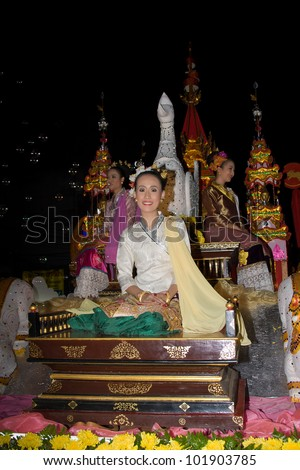 CHIANG MAI, THAILAND - NOVEMBER 11: Thai girl takes part in a parade of the Loy Krathong Festival in Chiang Mai, Thailand on November 11, 2011