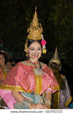 CHIANG MAI, THAILAND - NOVEMBER 11: Thai lady takes part in a parade of the Loy Krathong Festival in Chiang Mai, Thailand on November 11, 2011