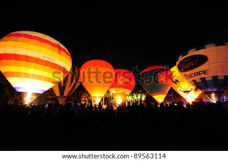 CHIANG MAI, THAILAND  - NOVEMBER 25: Unidentified hot air balloons glowing in the night during Thailand International Balloon Festival 2011 at Prince royal college in Chiangmai, Thailand on November 25, 2011.