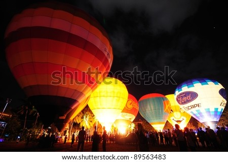 CHIANG MAI, THAILAND  - NOVEMBER 25: Unidentified hot air balloons participate the show in Thailand International Balloon Festival 2011 at Prince royal college in Chiangmai, Thailand on November 25, 2011.