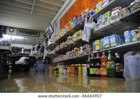 CHIANG MAI THAILAND - SEPTEMBER 29 : Flooding the Chiangmai city.Flood damage over a wide area stores on September 29,2011 in Chiangmai,Thailand