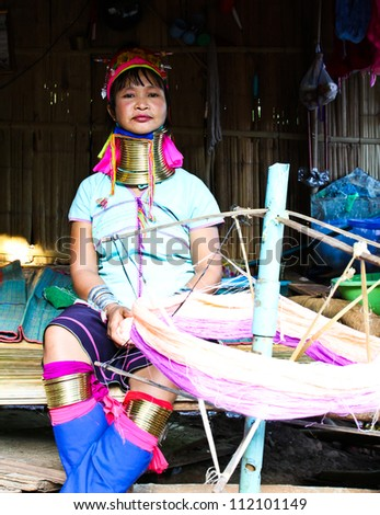CHIANG RAI,THAILAND-AUGUST 25: Unidentified Karen tribe woman poses for the camera in Chiang Rai, Thailand on August 25, 2012.The Karen people wear brass rings around their neck from as young as five years old.