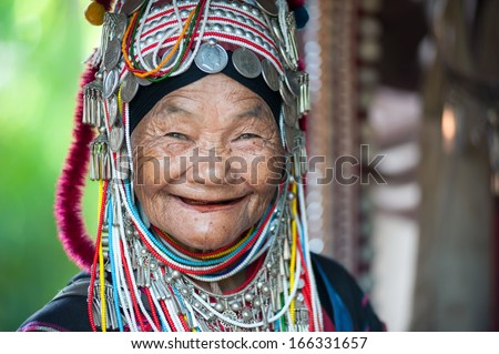 CHIANG RAI THAILAND DEC 4 Unidentified Akha tribe elderly woman with traditional clothes and silver jewelery in hill tribe minority village on December 4 2013 Mae Hong Son Thailand