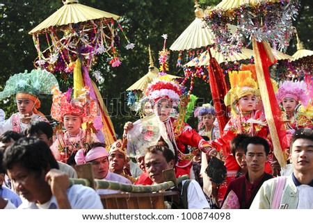CHIANGMAI, THAILAND-APRIL 1:Poi Sang Long festival, A Ceremony of unidentified boys to become novice monk, during in parade around township on April 1, 2011 in Chiangmai, Thailand.