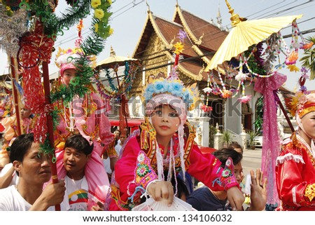 CHIANGMAI, THAILAND-APRIL 5:Poi Sang Long festival, A Ceremony of unidentified boys to become novice monk, during in parade around township on April 5, 2013 in Chiangmai, Thailand. - stock photo