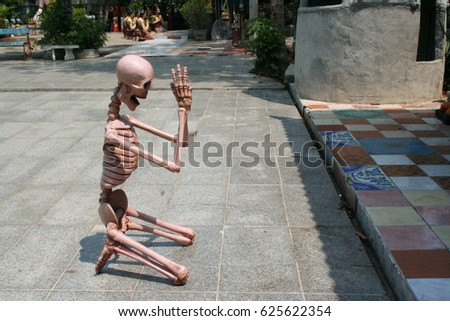 CHIANGMAI, THAILAND-APRIL 7: Skeleton statue with pay respect emotional on the floor of buddhist temple on April 7,2017 in Maegadnoi Temple, Chiangmai, Thailand. #625622354
