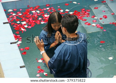 CHIANGMAI, THAILAND - AUGUST 8, 2015 : Ceremony of baptism. Christians make baptism in water pond at Chiangmai Fellowship Church in Chiangmai, Thailand. #379375822