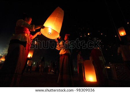 CHIANGMAI THAILAND - FEB 12: Unidentified beautiful thai girls floating lamp in san-sin-tin-tra-karn festival on February 25, 2012  in Chiangmai, Thailand. - stock photo