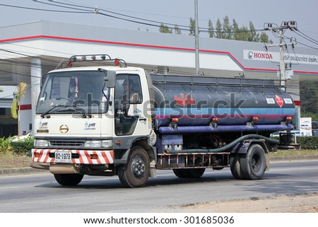 CHIANGMAI , THAILAND -FEBRUARY 6 2015:  PTT Oil Truck of Sukhum Oil transport Company. Photo at road no 1001 about 8 km from downtown Chiangmai, thailand.