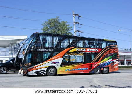 CHIANGMAI , THAILAND -JANUARY 11 2015: Travel bus of Manus Junpetch Travel Company. Photo at road no.1001 about 8 km from downtown Chiangmai, thailand.