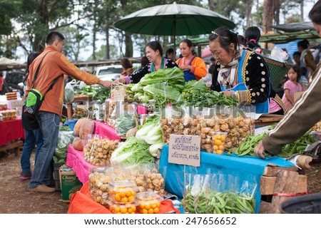 CHIANGMAI, THAILAND - JANUARY 18 : Unidentified minority selling stuffs in traditional tribal market in tribe minority village on January 18, 2015 in Chiangmai, Thailand.