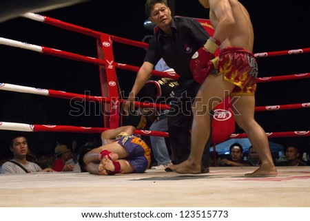 CHIANGMAI, THAILAND - JANUARY 2 : Unidentified Muay Thai fighters compete in a Thai boxing match at Mueng-kaen Fight on January 2, 2013 in Mae Tang district Chiangmai, Thailand.