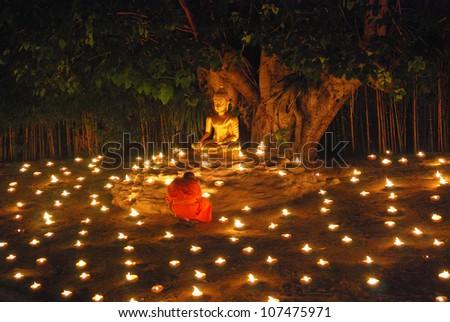 CHIANGMAI, THAILAND - JUNE 4 : Lord Buddha Day or Makha Bucha Day, Buddhist monks praying to the Buddha. June 4, 2012 in Phan Tao Temple, Chiangmai, Thailand. - stock photo