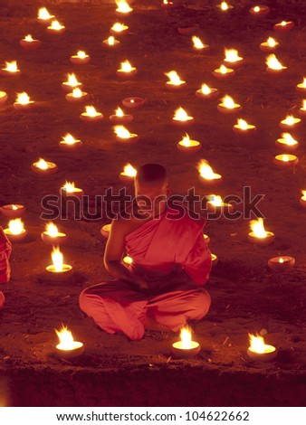 CHIANGMAI, THAILAND - MARCH 7 : Lord Buddha Day or Makha Bucha Day, An unidentified Buddhist monk praying to the Buddha. MARCH 7,2012 in Phan Tao Temple, Chiangmai, Thailand.