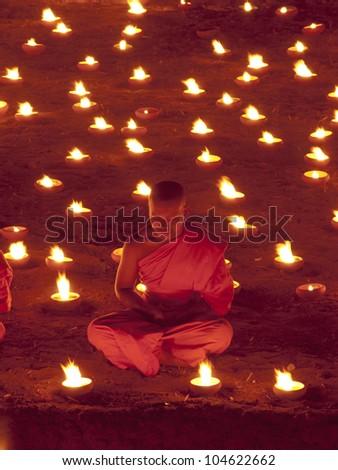 CHIANGMAI, THAILAND - MARCH 7 : Lord Buddha Day or Makha Bucha Day, An unidentified Buddhist monk praying to the Buddha. MARCH 7,2012 in Phan Tao Temple, Chiangmai, Thailand. - stock photo