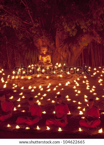 CHIANGMAI, THAILAND - MARCH 7 : Lord Buddha Day or Makha Bucha Day, Buddhist monks praying to the Buddha. MARCH 7,2012 in Phan Tao Temple, Chiangmai, Thailand.