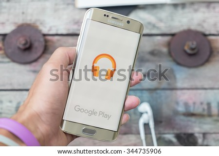 CHIANGMAI, THAILAND -NOV 28, 2015, A man hand holding screen shot of google play music on samsung galaxy s6 edge. Google play music is the most interesting and a user friendly app to listen to music.