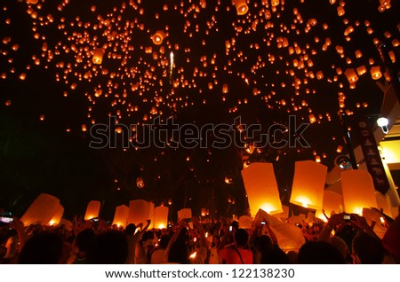 CHIANGMAI,THAILAND- NOV 24:People release sky lanterns to worship Buddha's relics in Yi Peng festival on November 24,2012 in Chiangmai. This festival occurs on every the 12th Thai lunar month.