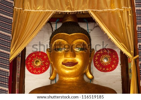 CHIANGMAI,THAILAND-OCTOBER 13 : Ancient golden Buddhas inside church age of about 200 years at Wat Klong Khan  temple on October 13,2012 in Chiangmai Province,Northern of Thailand.