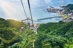 chiba, japan - july 18 2020: High angle view of pillars and wire cacles of the ropeway of Mount Nokogiri or sawtoothed mountain leading to the Kanayama port of Futtsu town in Tokyo bay.
