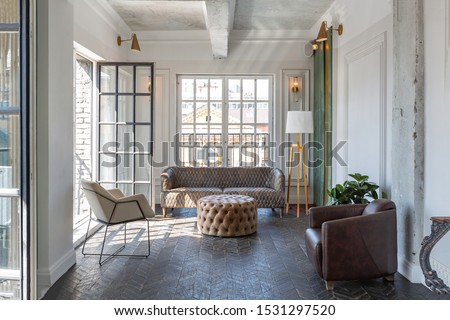Chic, luxurious guest room design with old-fashioned antique furniture. white walls are decorated with relief. there is a beautiful dark brown parquet on the floor.
