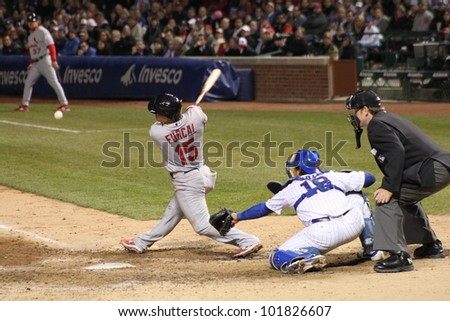 CHICAGO - APRIL 25: Rafael Furcal of the St. Louis Cardinals hits a ball during a game against the Chicago Cubs at Wrigley Field on April 25, 2012 in Chicago, Illinois.