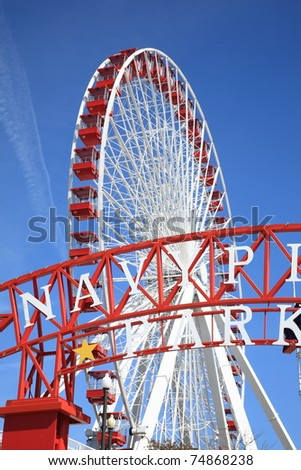 CHICAGO - APRIL 26: The 150 foot tall ferris wheel at Navy Pier awaits visitors on April 26, 2010 in Chicago, Illinois. Built in 1995, the 40 enclosed cars of the wheel can carry up to 240 people.