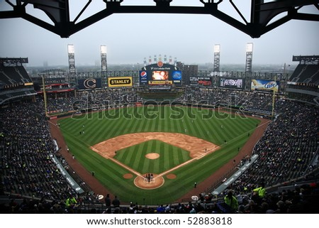 CHICAGO - APRIL 25: White Sox baseball players under the lights and famous upper deck facade at U.S. Cellular Field on April 25, 2010 in Chicago, Illinois.