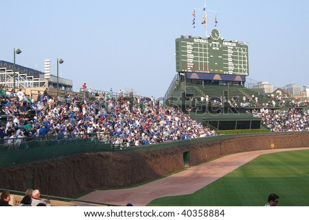 CHICAGO - APRIL 21 : Wrigley Field bleacher fans watch an early season Cubs baseball game on April 21, 2008 in Chicago.