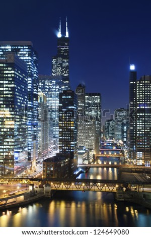 Chicago at night. Image of Chicago downtown and Chicago River with bridges at night.