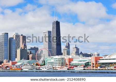 Chicago city downtown urban skyline with skyscrapers over Lake Michigan with cloudy blue sky. #212408890