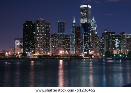 Chicago city skyline and reflection at night