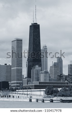 Chicago city urban skyline black and white with skyscrapers over Lake Michigan with cloudy sky.