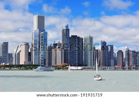 Stock Photo Chicago city urban skyline with skyscrapers over Lake Michigan with cloudy blue sky.