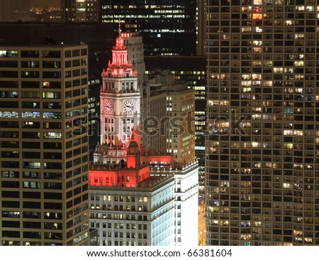 CHICAGO - DECEMBER 1:  The Wrigley Building clock tower is bathed in beautiful red lights on December 1, 2010 in celebration of the passing of the Illinois Civil Union bill.