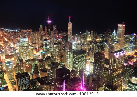Chicago downtown aerial view at night with skyscrapers and city skyline at Michigan lakefront. - stock photo