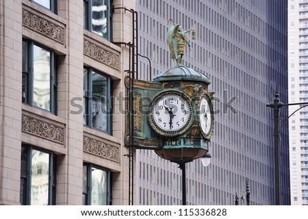 Chicago downtown street view with old fashion clock and skyscraper building.