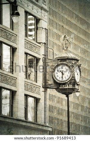 Chicago downtown street view with old fashion clock and skyscraper building in black and white.