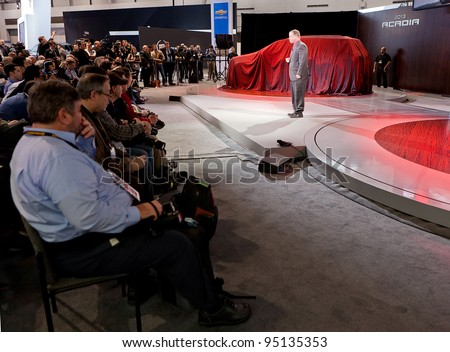CHICAGO - FEB 8: Members of the media await the unveiling of the 2013 GMC Acadia at the 2012 Chicago Auto Show Media Preview on February 8, 2012 in Chicago, Illinois.