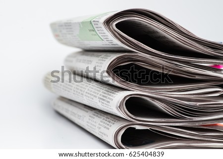 Chicago- Feb 12,2017:  stack of folded newspapers The Wall Street Journal and Chicago Tribune on white background(for editorial use only)