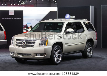 CHICAGO - FEBRUARY 8 : A Cadillac Escalade on display at the Chicago Auto Show media preview February 8, 2013 in Chicago, Illinois. - stock photo
