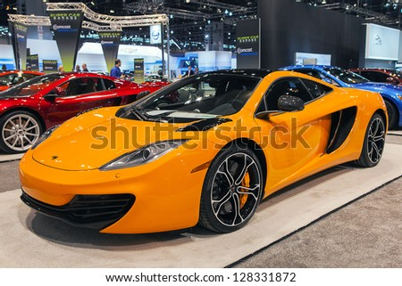 CHICAGO - FEBRUARY 7 : A McLaren super car display at the Chicago Auto Show media preview February 7, 2013 in Chicago, Illinois. - stock photo