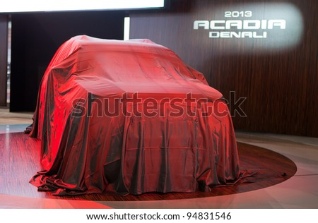 CHICAGO - FEBRUARY 8: The 2013 GMC Acadia Denali its under wraps at the 2012 Chicago Auto Show Media Preview on February 8, 2012 in Detroit, Michigan.
