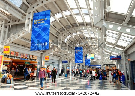 "CHICAGO, IL - MAR 31: Chicago O'Hare Airport interior on March 31, 2013 in Chicago, Illinois. It is the world's second busiest airport and was voted the ""Best Airport in North America"" for 10 years"