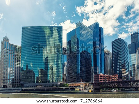 Chicago, Illinois - June 18, 2017: 333 West Wacker Drive is a highrise office building in Chicago, Illinois. On the Chicago River side, the building features a curved green glass facade.