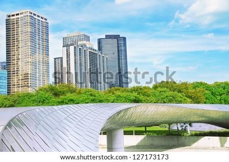 CHICAGO, ILLINOIS - SEPTEMBER 9: BP Bridge on September 9, 2012 in Chicago, Illinois. BP Bridge, by Frank Gehry, is a girder footbridge in the Loop community area. - stock photo