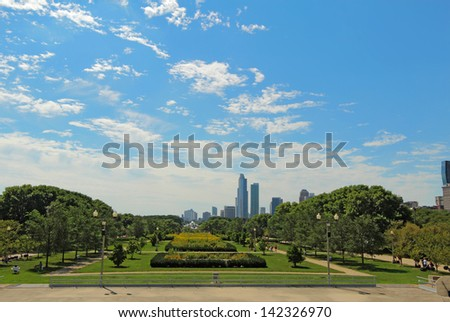 CHICAGO, ILLINOIS - SEPTEMBER 4: Millennium Park and partial skyline of Chicago, Illinois, on September 4, 2011. The park is a popular destination for tourists in the center of downtown Chicago.