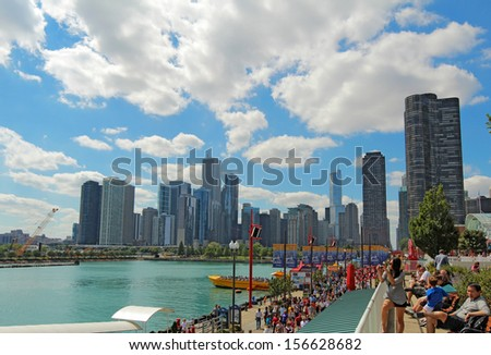CHICAGO, ILLINOIS - SEPTEMBER 4: Tourists and a view of the cityscape at Navy Pier in Chicago, Illinois on September 4, 2011. The Pier is a popular destination with many attractions on Lake Michigan.