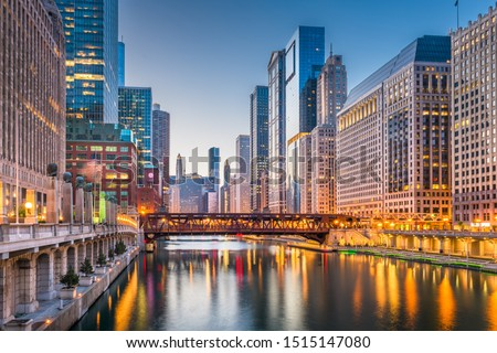 Chicago, Illinois, USA cityscape on the river at twilight.